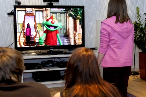 Family playing Sesame Street using a Kinect